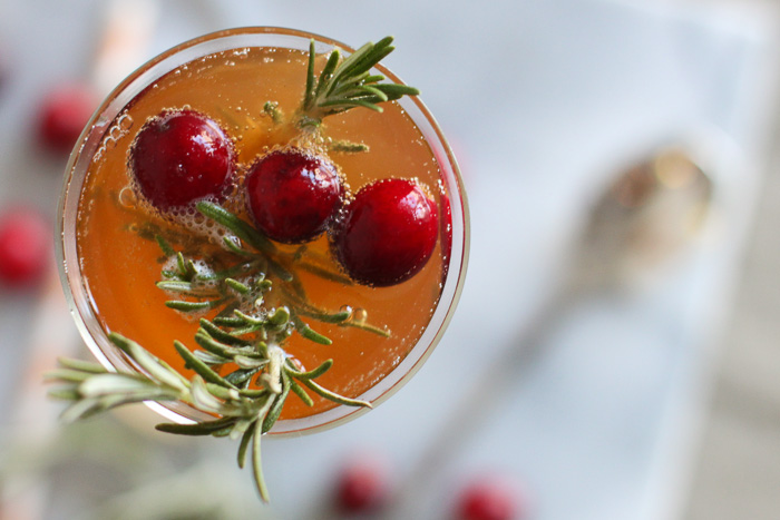 Cranberry and Rosemary garnished kombucha champagne cocktail